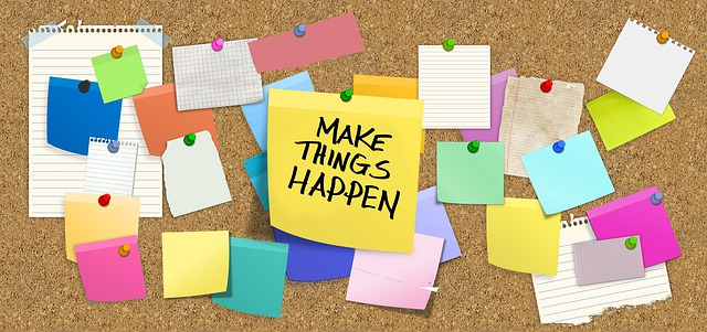 pin board with post it notes. One reads 'make things happen'