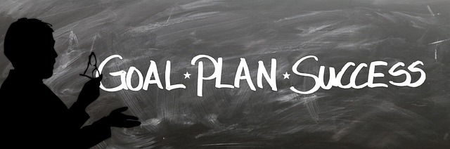 blackboard with the word goal plan success