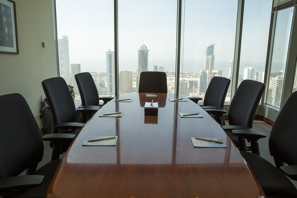 Marketing Board room. Chairs around a table in a room with the view of a city.